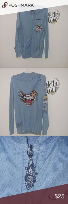 """Ed Hardy Men's L Blue Full zip sweatshirt/hoodie Pre-Loved in Great condition.(no rips, no stains)  Ed Hardy by Christian Audigier Blue Full zip sweatshirt with hoodie, Tiger Embelished print in the back, Ed hardy brand embroided, eagle print in front and left arm.  100% Cotton Zipper closure Zip up hoodie with Logo pull 2 side pockets Featuring Tiger, eagle, and death before dishonor artwork. Lightweight and soft confortable fit.  Measurements (Laying Flat) Chest:20.5"""" Sleeve: 29.5"""" Lenght…"""