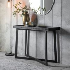 Boho Chic Console Table  The Boho Chic Console Table is made using Mango solids with mixed timber veneers of Teak-Mahogany-Mindy Ash and Mango which give contrast and make the inlaid pattern stand out. It has a stunning mat black charcoal or brown finish – the different grains in the mixed timbers stand out in the light and catch your eye with this beautiful detail. The table features a patterned frieze of blind fret work, made from solid mango wood, around the tray-style top.