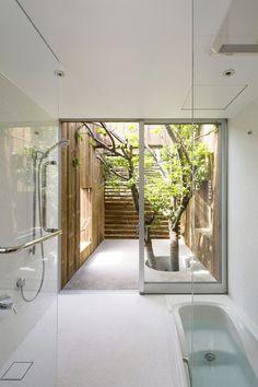 Glass Shower | Soaking Tub | Open Atrium