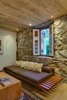 Impressive Casual House Design with Great Backyard: Unique Wooden Sofa In The Casa Fazenda Living Room With Stone Wall And Wooden Ceiling Ab...