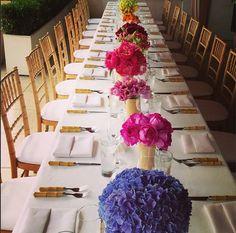 Amazing multi-colored flower arrangements for a LA Luncheon instagram.com/aerin
