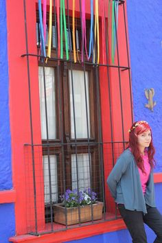 Mexican colorful house and red hair girl