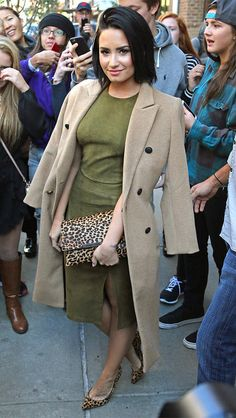 Demi Lovato in an army green Alice + Olivia halter and midi skirt, camel coat, and leopard heels and clutch - click ahead for more fall outfit ideas