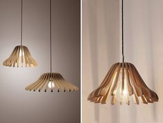 DIY Lamps and Chandeliers - I absolutely love this pendant lamp made from hangers. It's a totally cool idea that you can make yourself, and the materials are so original!