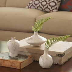 Hopkins Terracotta Vases   Artfully antiqued in the style of ancient pottery, these terracotta vases offer Old World appeal to your home. Set of 3.