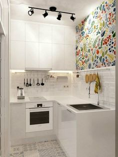 Modern Kitchen Injecting Color Into A Tiny White Space More - Don't feel limited by a small kitchen space. Here are fifty designs for smaller kitchen spaces to inspire you to make the most of your own tiny kitchen. Small Apartment Kitchen, Micro Apartment, Cozy Apartment, Apartment Ideas, Apartment Interior, Studio Apartment Storage, Apartment Layout, Apartment Design, Apartment Living
