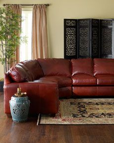 red leather sectional i would build around the bold color of red with dark wood furnishings