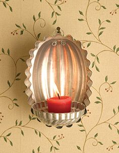 How cute is this wall sconce! I'm totally doing this! I've got lots of these vintage jello molds. Fun!
