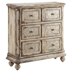 Hand-painted chest with floral drawer fronts.   Product: ChestConstruction Material: Wood  Color: Dist...