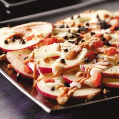 Apple Nachos Recipe -It doesn't get much easier than whipping together this colorful, crisp treat. These nacho look-alikes will delight any guest with a sweet tooth! —RaeAnn Gnatkowski, Carrollton, Michigan