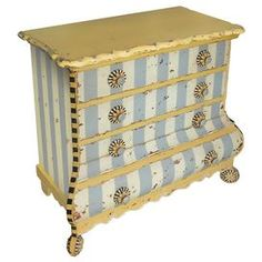 """Antiqued four-drawer chest with striped accents and flower pulls.        Product: Chest   Construction Material: WoodColor: Distressed yellow and blue      Features: Four drawers                  Dimensions: 30"""" H x 30"""" W x 15"""" D"""
