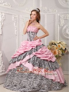 Romantic Pink Quinceanera Dress Strapless Taffeta and Zebra Beading Ball Gown  http://www.fashionos.com  If you are looking for the romantic and sweet detailed ball gowns of Christmas, this one may be just what you're looking for.It has a strapless bodice with a beading accented neckline and romantic pink and zabra-printed fabric throughout. The skirt is embellished with ruffles that complement the beadwork in the bodice perfectly and the corset style bodice is finished with a lace up tie…