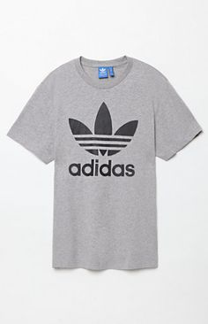 Online Only! adidas does laid-back athletic style right with the Originals Trefoil T-Shirt. This go-to tee features a classic crew neck, short sleeves, and a bold adidas Trefoil graphic on the front.   Grey heathertee adidas graphic on front Crew neck Short sleeves 100% organic cotton single jersey Imported