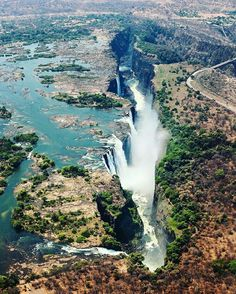 The magnificent Victoria Falls on the Zambezi River at the border of Zambia and…