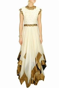 This white flaired anarkali suit is featuring in a cream net long multi layer gown with asymmetrical triangular hem. The details of this anarkali suit includes floral sequins and metal antique embellishment on crepe bodice. Anarkali Dress, Pakistani Dresses, Indian Dresses, Indian Outfits, Lehenga, Anarkali Suits, Dance Outfits, Dance Dresses, Salwar Kameez