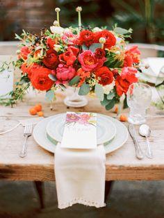 gorgeous flower centerpiece filled with red ranunculus I Oatlands Plantation Wedding Inspiration
