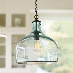 'Globo' Glass Pendant Light | dotandbo.com. Great lines and I like that you can see the bulb but I wonder how harsh the light would be