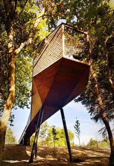 The long narrow bodies of snakes inspired the shapes of this pair of matching woodland hideaways