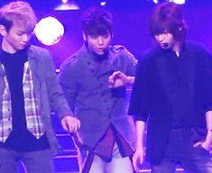 "Caption: ""taekey conspiring against jonghyun"" (SHINee).  (.gif set)."
