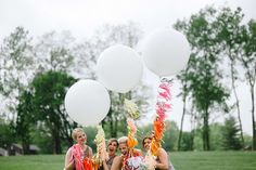 For fun photo ops, get giant balloons from a local party store and add brightly colored paper tassels to the strings: