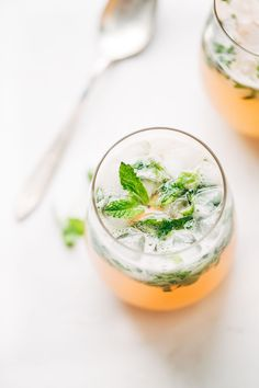 Grapefruit Mojitos - the perfect recipe for two! Grapefruit juice, lime juice, honey, mint leaves, white rum, and sparkling water. Naturally sweet and pink!
