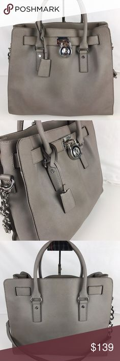 """Michael Kors Large Signature Hamilton Satchel Used. Exterior in good shape. Inside liner is a mess of stains that may or may not come out with a good cleaning. Wear on hardware. See photos. Priced accordingly.   Double handles with 4"""" drop; shoulder strap with 14-1/2"""" drop. Magnetic snap closure. Signature charms. Interior features zip pocket, 4 slip pockets and key fob 14"""" W x 13"""" H x 6-1/4"""" D Style 30T2SHMT3L. Our bag # RB292  Thank you for your interest! No Trades.  PLEASE - NO TRADES…"""