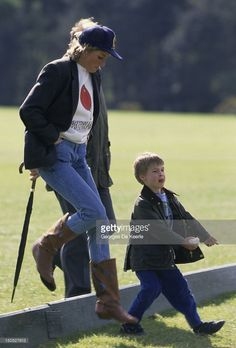 Prince William with his mother Diana, Princess of Wales at Guards Polo Club. The Princess is casually dressed in a sweatshirt with the British Lung Foundation logo on the front of her t-shirt.