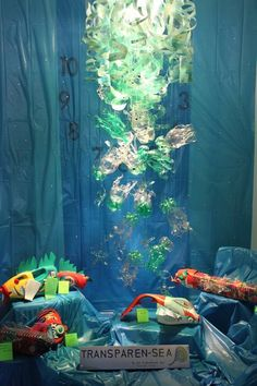 Dale Chihuly inspired art done by children using plastic pop bottles!!