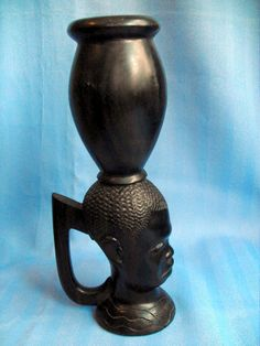 """B7284 £SOLD privately (Nov 2015) Striking unusually tall vintage African carved solid ebony (probably coramandel ebony) figural jug with handle standing on a base which is in the form of a boy's head.  It stands approximately 12"""" high."""