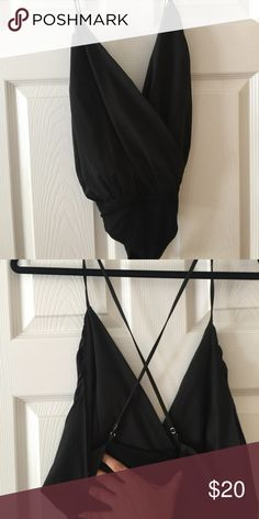 Black Bodysuit Black bodysuit. Straps can be adjusted. Open back. This is not a full coverage bottom, it is more of a cheeky thong cut. Tops Blouses