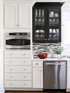 add drama to the kitchen with contrasting cabinets and a graphic tile backsplash