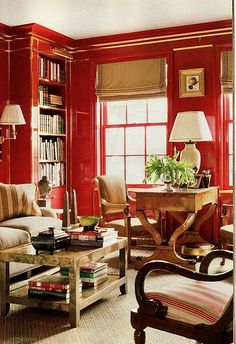 Libby Wilkie - red lacquered wall library accented with neutrals and metallics
