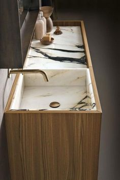 This wood vanity with integrated marble sink and counter is so handsome. | japanesetrash.com