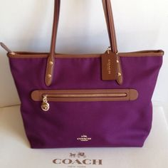 """NWT Coach Sawyer Plum Polyester Twill ZipTote Coach NWT Coach Sawyer plum twill with leather trim tote. Outside pocket trimmed in leather with gold pull. Bottom trimmed in leather. Inside lavender satin lining with zippered pocket and two slip pockets. Handles with 9"""" drop.  Top closure is zippered.  Beautiful plum color!  No Trades F37237 Coach Bags Totes"""