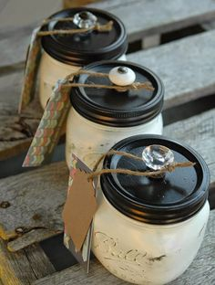 Distressed Painted Mason Jars | 1. Glue the two pieces of your lids together then spray with ORB spray paint. 2. Paint mason jars with chalk paint, sand and seal with polycrylic. 3. Glue on curio knobs.