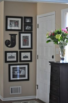 Nice photo arrangement for narrow wall.  From: Our Southern Table: Creating an Entry-Way
