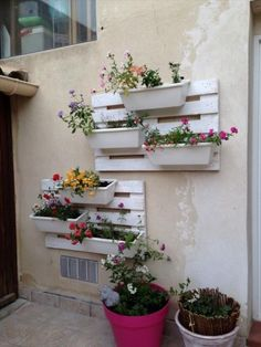 Old Pallets Floral wall in pallet wall pallet outdoor project diy pallet ideas with Planter Pallets Wall Hanger - An easy way to dress our grey walls with repurposed pallet wood. Pour habiller nos murs tout gris!