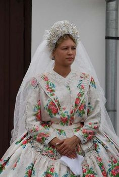 A bride's traditional dress in Báta, Hungary. So beautiful.