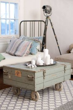 Add industrial casters to a vintage wooden military type footlocker for a unique coffee table