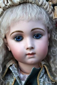 Offered out of a fine collection of french dolls (more to come over the next few months) is this tender and beautiful Bebe Triste by Emile Jumeau in a