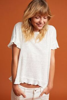Anthropologie Ruffled Cross-Back Top https://www.anthropologie.com/shop/ruffled-cross-back-top?cm_mmc=userselection-_-product-_-share-_-4112277333121