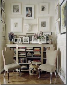 A vignette with four of my favorite elements: a chevron floor, interesting chairs, books, and art hung gallery style.