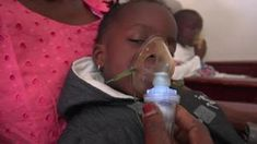 Two-year-old Thayi loves the aerosol therapy room at Senegal's Albert Royer Children's Hospital, where she gets to fall asleep on her mother's lap, breathing Lung Infection, Head Of State, Science News, Health Center, Two Year Olds, Childrens Hospital, Environmental Science, Air Pollution, Earth Science