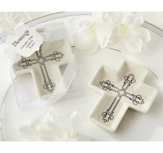The Blessings Ceramic Cross Trinket Dish is the perfect place to put meaningful treasures.  Designed with the dignity it deserves, this finely crafted cross trinket dish is a fitting keepsake for baptisms, christenings, and other faith-based occasions.  Dish is made from ceramic and has a decorative cross decal.  Comes in a clear display gift box with a white organza ribbon and a hangtag, all packaged and ready to give to your guests!