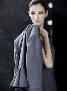 Luxe superfine wool back flounce jacket with pleated border sleeve detail.