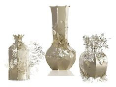 Laser cut metal vases (among other things). Incredible.