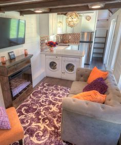 Alabama Tiny Homes used salvaged cypress wood for the interior walls. The spacious living room is large enough for a full-size couch, chair, and electric fireplace.