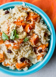Sweet Potato Coconut Cashew Rice...  [NEED: sweet potato, Basmati rice, vegetable broth, salt, olive oil, coconut milk, garlic powder, ginger powder, cayenne, pepper, bay leaf, sweet onion, maple syrup, raisins, cashews, shredded coconut,cilantro to garnish]