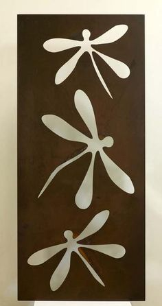 The simple and playful element of the dragonfly on our contemporary wall panel has turned a sheet of rusted metal into a work of art. It's visual appeal will make it the focal point of an outside wall, particularly if it is back lit. The beauty of the materials and design can be equally enjoyed on interior walls.      NB: If out of stock please allow 4-6 weeks lead time