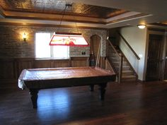 Billiard room with cherry wainscot and brick uppers Basement Wainscoting, Wainscoting Panels, Engineered Hardwood Flooring, Hardwood Floors, Wet Bar Cabinets, Copper Farm Sink, Billiard Room, Repurposed Wood, Basement Renovations